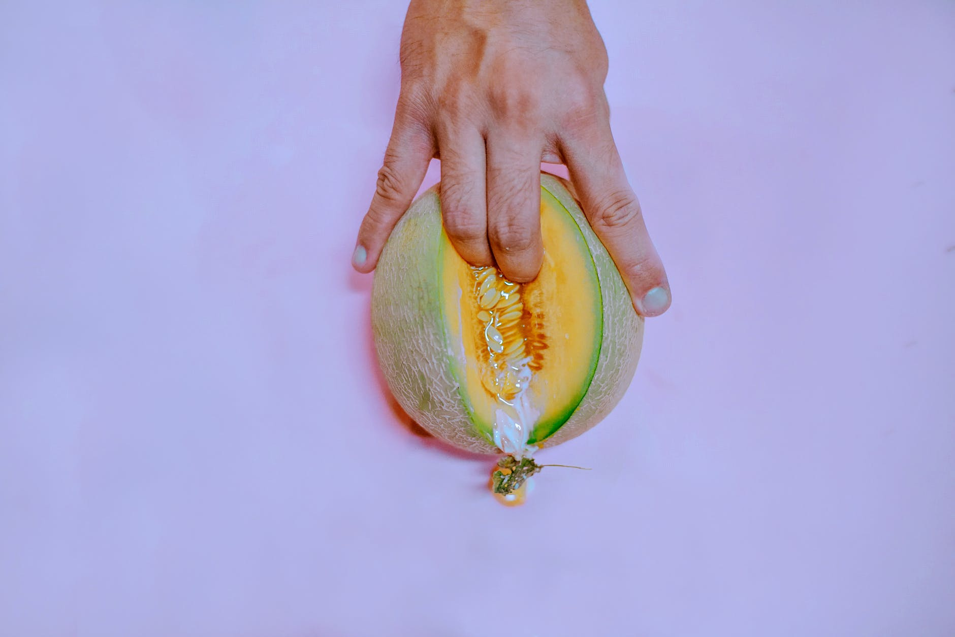 fingers on melon