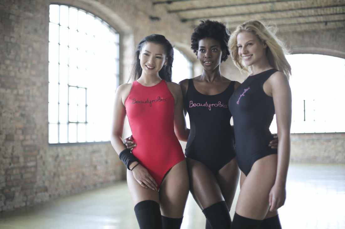 photo of women wearing one piece swimsuit