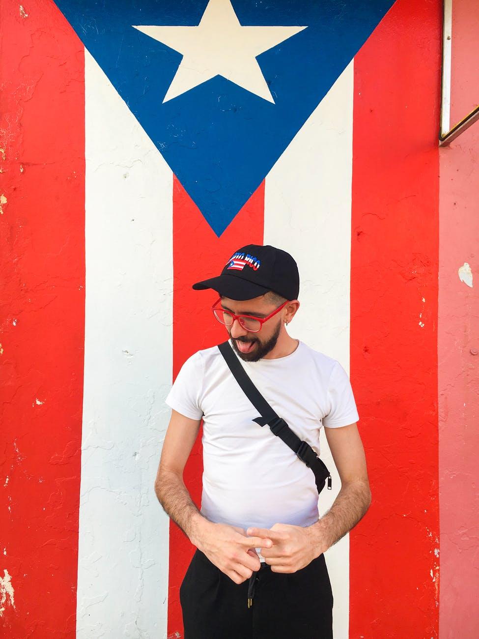 man standing near puerto rico flag